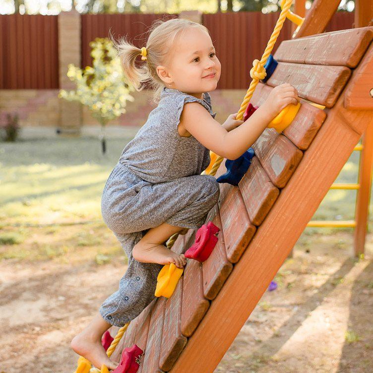 girl-climbing-up-playground-ladder