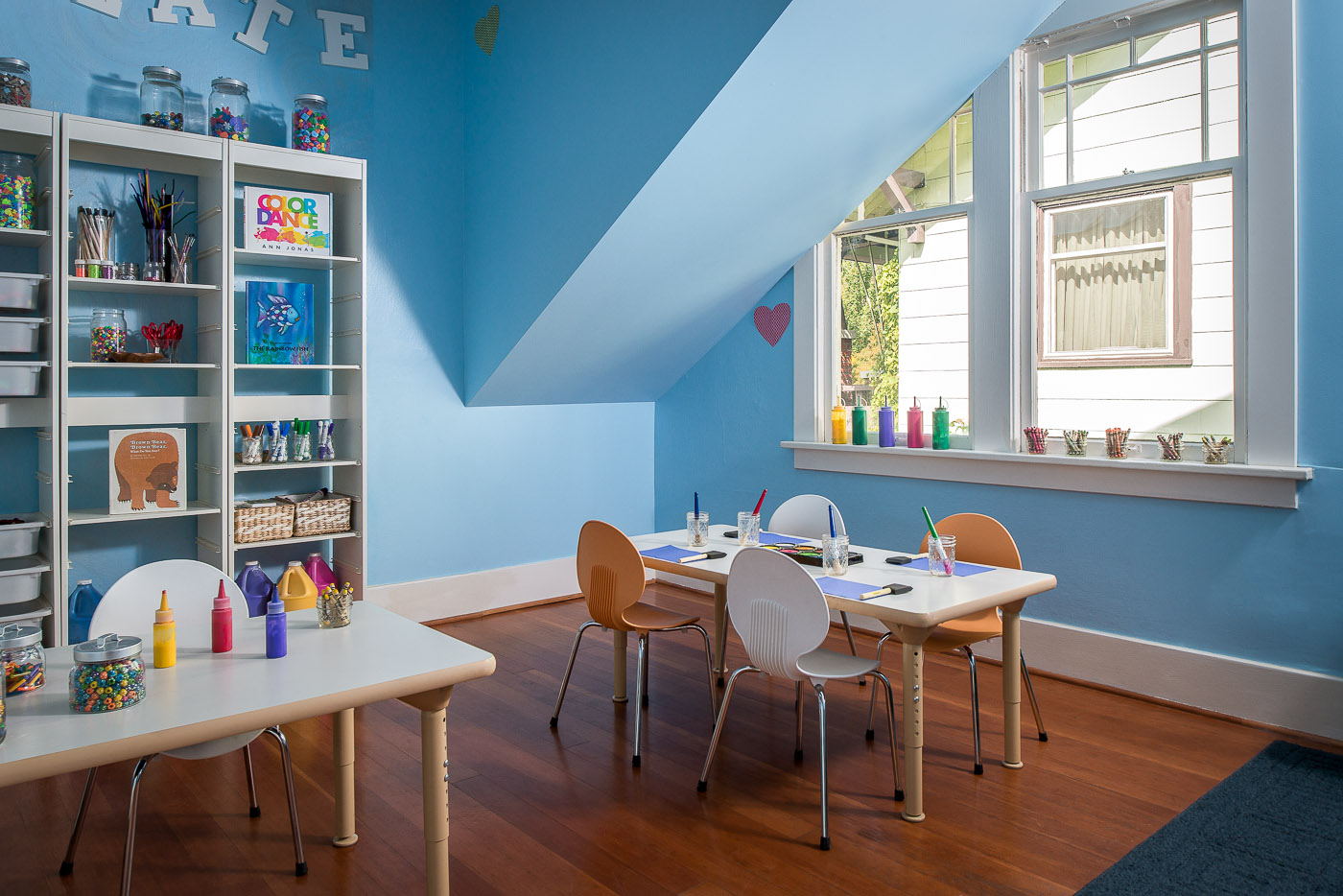 Blue room with art supplies for kids and teachers