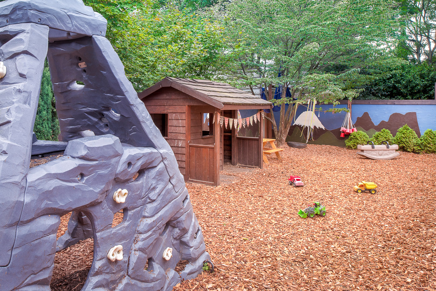 Outdoor playground and climbing rock for kids