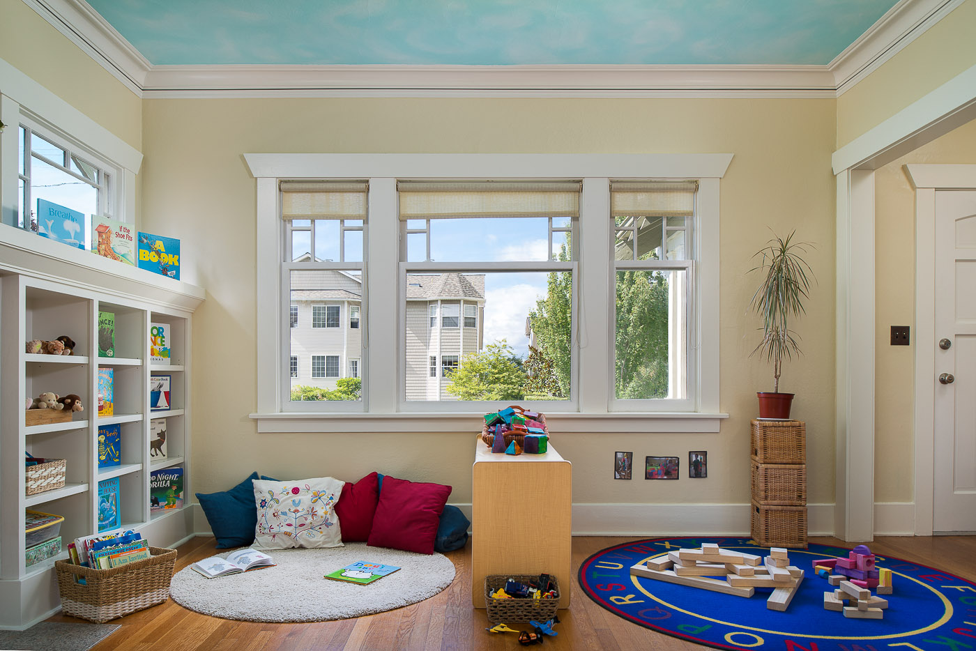 Sitting area for preschool kids with toys and wooden blocks