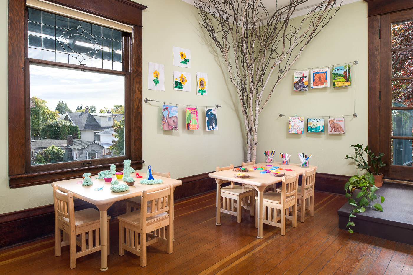 Interior Seattle preschool building with kid tables, art projects and toys