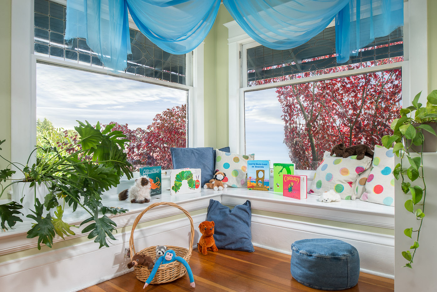 Preschool reading nook with books and stuffed animals for kids to engage